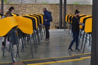 Voting Centers practice social distancing and face mask requirements, along with new voting machines