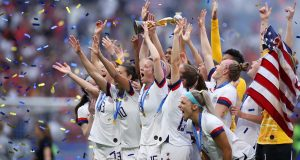 LYON, FRANCE - JULY 07:  Megan Rapinoe of the USA lifts the FIFA Women's World Cup Trophy following her team's victory in the 2019 FIFA Women's World Cup France Final match between The United States of America and The Netherlands at Stade de Lyon on July 07, 2019 in Lyon, France. (Photo by Alex Grimm/Getty Images)