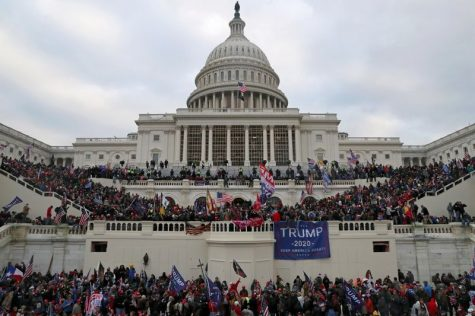 A mob of supporters of U.S. President Donald Trump storm the U.S. Capitol Building in Washington, U.S., January 6, 2021.