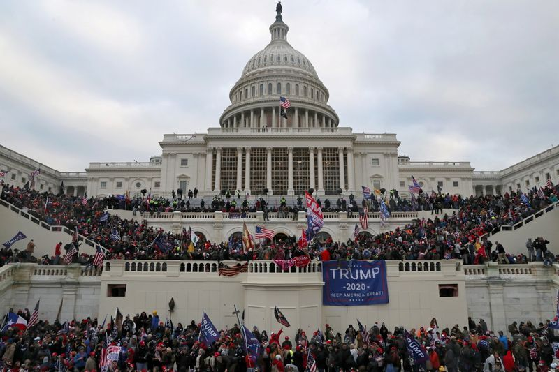 A+mob+of+supporters+of+U.S.+President+Donald+Trump+storm+the+U.S.+Capitol+Building+in+Washington%2C+U.S.%2C+January+6%2C+2021.