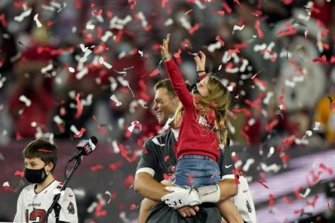 Tampa Bay Buccaneers quarterback Tom Brady celebrates with his family after their NFL Super Bowl 55 football game against the Kansas City Chiefs. The Buccaneers defeated the Chiefs 31-9 to win the Super Bowl.
